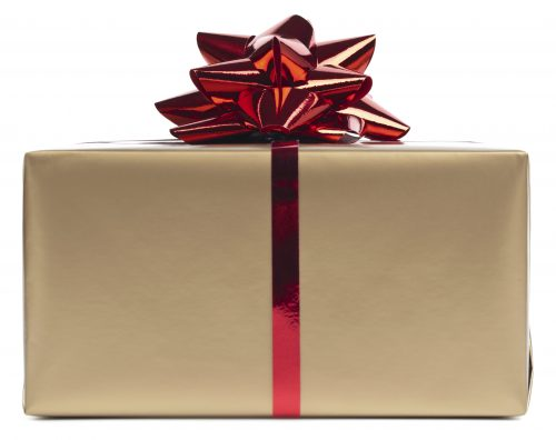 Gold gift box with red ribbon on white. This file contains clipping path.